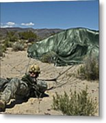 A Paratrooper Recovers After Landing Metal Print