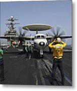 A Plane Director Guides An E-2c Hawkeye Metal Print