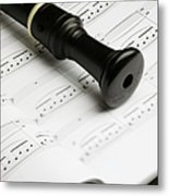 A Recorder Lying On A Book Of Sheet Music Metal Print by Studio Blond