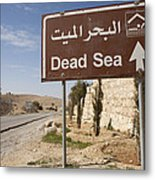 A Road Sign In Both Arabic And English Metal Print by Taylor S. Kennedy