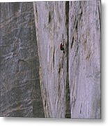 A Rock Climber Clings To An Overhang Metal Print