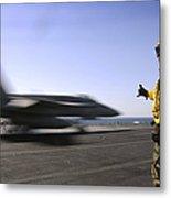 A Sailor Ensures An Fa-18c Hornet Metal Print by Stocktrek Images