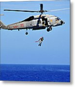 A Search And Rescue Swimmer Is Lowered Metal Print
