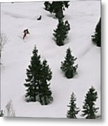A Skier Makes His Way Down A Hill Metal Print