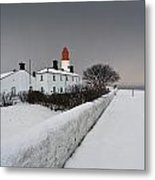 A Snow Covered Fence With A Lighthouse Metal Print by John Short
