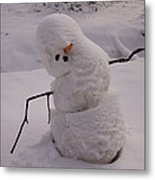 A Snowman Sitting In The Snow Metal Print