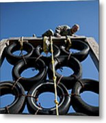 A Soldier Climbs Over A Tire Tower Metal Print