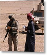A Soldier Communicates With A Local Metal Print