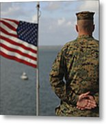 A Soldier Stands At Attention On Uss Metal Print