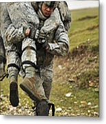 A Soldier Transports A Fellow Wounded Metal Print