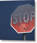A Stop Sign Covered In Snow Metal Print by John Burcham