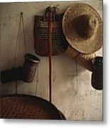 A Straw Hat, Straw Baskets And A Belt Metal Print