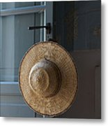 A Sun Hat Hangs On The Door Of A Tuscan Metal Print