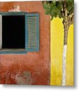 A Tree Outside A Colorful Building And Metal Print