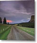 A Twilight View Down A Dirt Road Metal Print