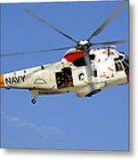 A Uh-3h Sea King Helicopter Flies Metal Print