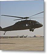 A Uh-60 Black Hawk Landing Metal Print