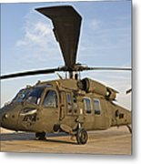 A Uh-60 Black Hawk Parked At A Military Metal Print
