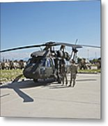 A Uh-60l Blackhawk Parked On Its Pad Metal Print