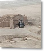 A Us Army Black Hawk Helicopter Hovers Metal Print