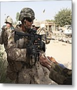 A U.s. Marine Gives A Piece Of Candy Metal Print