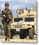 A U.s. Marine Guides A Humvee Metal Print