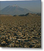 A Volcano Rises Above A Dry Lake Bed Metal Print