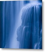 A Waterfall Splashes Off Of A Large Metal Print