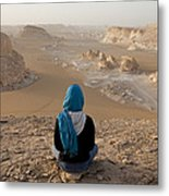 A Woman Sits Quietly On A Cliff Looking Metal Print