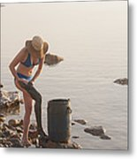 A Woman Smears Therapeutic Dead Sea Mud Metal Print by Taylor S. Kennedy