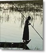 A Woman Stands At The End Of A Rowboat Metal Print