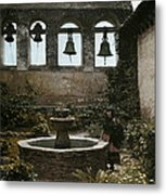 A Woman Stands Next To A Fountain Metal Print