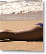 A Woman Sunbathes On The Beach Metal Print