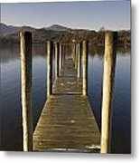 A Wooden Dock Going Into The Lake Metal Print