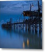 A Wooden Pier With Lights On It At Metal Print