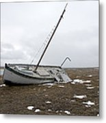 A Wooden Sailboat Is Beached Metal Print