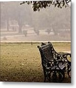 A Wrought Iron Black Metal Bench Under A Tree In The Qutub Minar Compound Metal Print