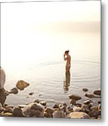 A Young Woman Wades Into The Dead Sea Metal Print