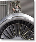 Airman Checks Components Atop A C-5 Metal Print