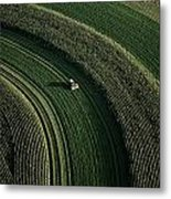 An Aerial View Of A Tractor On Curved Metal Print