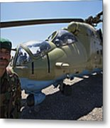An Afghan Army Soldier Guards An Mi-35 Metal Print