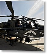 An Ah-64d Apache Helicopter Parked Metal Print
