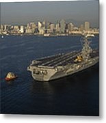 An Aircraft Carrier With The Skyline Metal Print