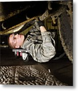 An Airman Inspects The Undercarriage Metal Print by Stocktrek Images