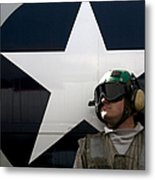 An Airman Stands In Front Of A C-2a Metal Print