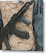 An Ak-47 Rests On The Sling Of An Metal Print