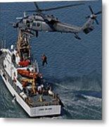 An Hh-60g Pave Hawk Performs A Hoist Metal Print