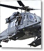 An Hh-60g Pavehawk Helicopter In Flight Metal Print