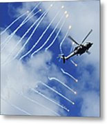 An Hh-60h Sea Hawk Helicopter Releases Metal Print