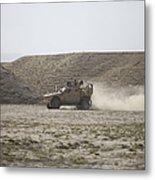 An M-atv Races Across The Wadi Metal Print
